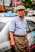 Portrait of a cab driver in the city center of Daegu. Daegu, also known as Taegu and officially the Daegu Metropolitan City, is the third largest metropolitan area in South Korea.