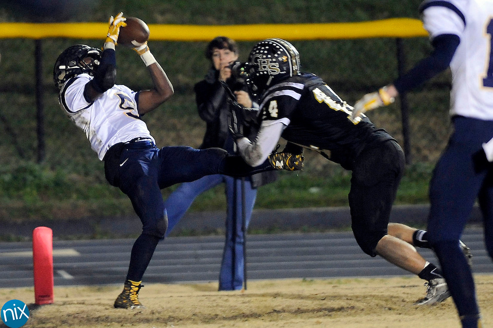Spiders defensive back Carter Mozingo (14, right) couldn't stop Vikings slot back Lundon White (5, left) from catching this pass for a touchdown, making the score Vikings 7 to Spiders 12 after the successful extra point during the South Iredell Vikings at Concord Spiders 3A high school football playoff game on Nov. 27.