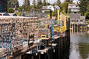 The lobster docks and pier piled high with traps in the quaint fishing harbor of Port Clyde, Maine.