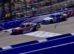 March 16, 2019 - Fontana, California, U.S. - FONTANA, CA - MARCH 16:  Christopher Bell (20) Rheem Toyota and race winner Cole Custer (00) Thompson Pipe/Haas Automation Ford  on the track during the NASCAR Xfinity Series  race on March 16, 2019 at Auto Club Speedway in Fontana, CA.  (Photo by Lyle Setter/Icon Sportswire) (Credit Image: © Lyle Setter/Icon SMI via ZUMA Press)