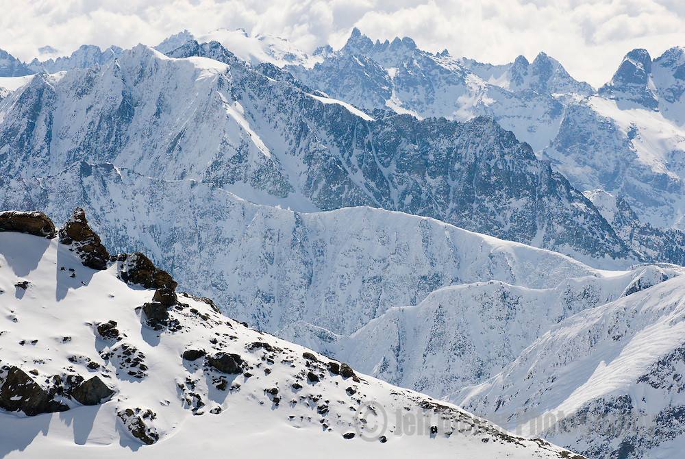 High peaks and ridgelines of the Swiss Alps.