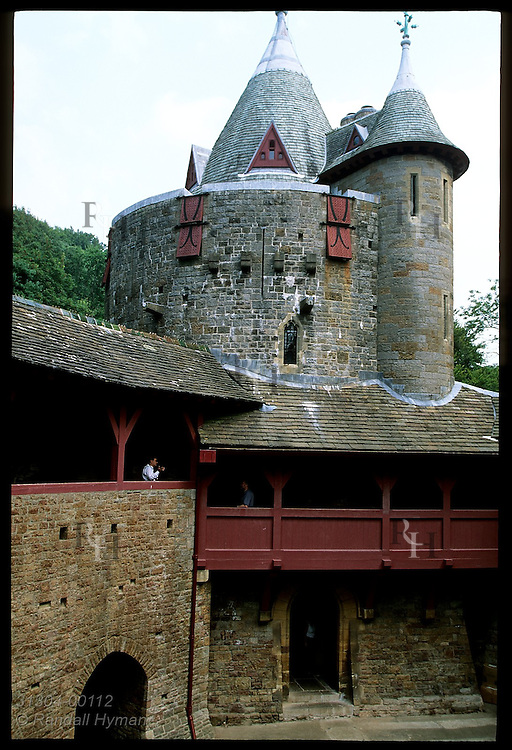 Courtyard view toward wel tower and gallery walkways at Castell Coch, built 1875-91 by Wm Burges for Lord Bute; Cardiff, Wales