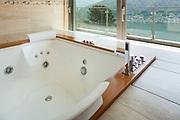 Interior of  luxury apartment, comfortable bathroom with jacuzzi