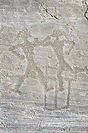 Petroglyph, rock carving, of two warriors boxing. Carved by the ancient Camunni people in the iron age between 1000-1200 BC. Rock no 6, Foppi di Nadro, Riserva Naturale Incisioni Rupestri di Ceto, Cimbergo e Paspardo, Capo di Ponti, Valcamonica (Val Camonica), Lombardy plain, Italy .<br /> <br /> Visit our PREHISTORY PHOTO COLLECTIONS for more   photos  to download or buy as prints https://funkystock.photoshelter.com/gallery-collection/Prehistoric-Neolithic-Sites-Art-Artefacts-Pictures-Photos/C0000tfxw63zrUT4<br /> If you prefer to buy from our ALAMY PHOTO LIBRARY  Collection visit : https://www.alamy.com/portfolio/paul-williams-funkystock/valcamonica-rock-art.html