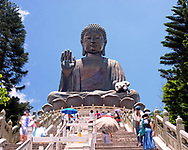 The Big Buddha sits on top of a mountain in the Ngong Ping area of Lantau island in Hong Kong. The pilgrimage to this great statue is made much more easily today with the introduction of a cable car from Tung Chung lifting visitors to the Po Lin monastery. From there it is a short walk up the steps to the lotus flower platform that this huge statue sits aloft. The Buddha is reported to weigh 250 metric tones, is 34 meters tall and constructed of bronze plates.<br /> <br /> Available to download for personal and commercial use or to purchase as a canvas print, photo print and framed photo print.