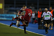 Owen Lane of Cardiff Blues is tackled by Duncan Williams (9) of Munster. Guinness Pro14 rugby match, Cardiff Blues v Munster Rugby at the Cardiff Arms Park in Cardiff, South Wales on Saturday 17th February 2018.<br /> pic by Andrew Orchard, Andrew Orchard sports photography.
