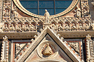 Cathederal - Detail of the facade.  Piazza del Duomo, Sienna Italy .<br /> <br /> Visit our ITALY PHOTO COLLECTION for more   photos of Italy to download or buy as prints https://funkystock.photoshelter.com/gallery-collection/2b-Pictures-Images-of-Italy-Photos-of-Italian-Historic-Landmark-Sites/C0000qxA2zGFjd_k<br /> If you prefer to buy from our ALAMY PHOTO LIBRARY  Collection visit : https://www.alamy.com/portfolio/paul-williams-funkystock/sienna-cathedral.html .<br /> <br /> Visit our ITALY PHOTO COLLECTION for more   photos of Italy to download or buy as prints https://funkystock.photoshelter.com/gallery-collection/2b-Pictures-Images-of-Italy-Photos-of-Italian-Historic-Landmark-Sites/C0000qxA2zGFjd_k<br /> .<br /> <br /> Visit our MEDIEVAL PHOTO COLLECTIONS for more   photos  to download or buy as prints https://funkystock.photoshelter.com/gallery-collection/Medieval-Middle-Ages-Historic-Places-Arcaeological-Sites-Pictures-Images-of/C0000B5ZA54_WD0s