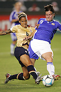 25 August 2007: Finland's Sanna Valkonen (4) blocks a shot from US forward Natasha Kai (6). The United States Women's National Team defeated the Women's National Team of Finland 4-0 at the Home Depot Center in Carson, California in an International Friendly soccer match.
