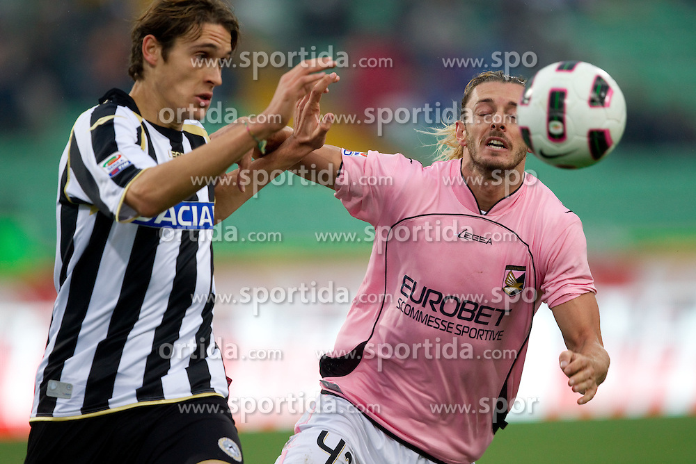 Angella Gabriele of Udinese vs Balzaretti Federico of Palermo during football match between Udinese Calcio and Palermo in 8th Round of Italian Seria A league, on October 24, 2010 at Stadium Friuli, Udine, Italy.  Udinese defeated Palermo 2 - 1. (Photo By Vid Ponikvar / Sportida.com)