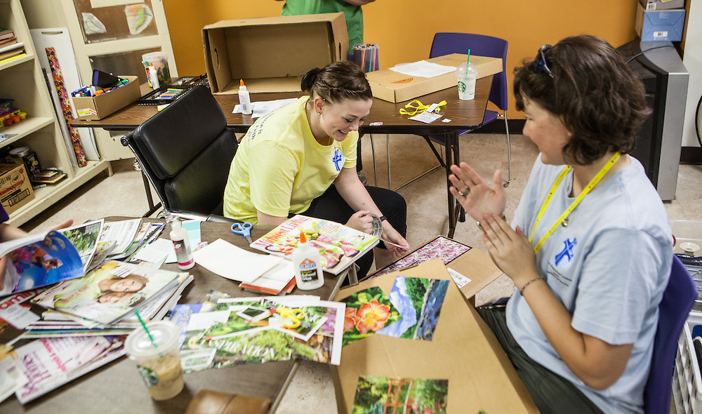 Lindsay Fertig '14 and Sarah Johnson '11 of the Lutheran Deaconess Association help decorate collection boxes for Dayspring Women's Center in Valpariaso, IN. (Jeff Lange)