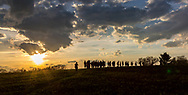 As day draws to an end, hikers crest a hill on the Ice Age Trail near Cross Plains. Photo taken May 6, 2018.