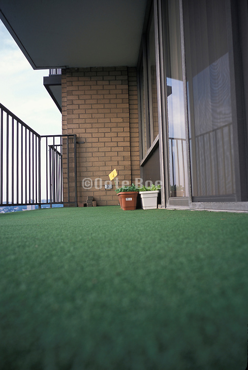 Balcony with fake green grass