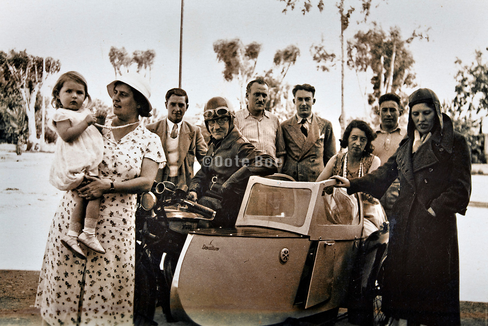 1930s Morocco western couple ready to go on a motorcycle vacation trip