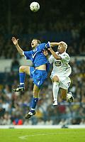Photo. Andrew Unwin<br /> Leeds United v Birmingham City, Barclaycard Premier league, Elland Road, Leeds 20/09/2003.<br /> Leeds' Alan Smith (r) battles in the air with Birmingham's Kenny Cunningham (l).