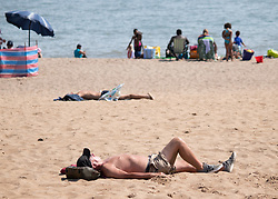 © Licensed to London News Pictures. 25/07/2019. Skegness, Lincolnshire, UK. Skegness seaside resort swelters under the summer heat. Sun, sea and sand. Photo credit: Dave Warren/LNP