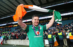 Ireland's Johnny Sexton celebrates winning the grand slam during the NatWest 6 Nations match at Twickenham Stadium, London.