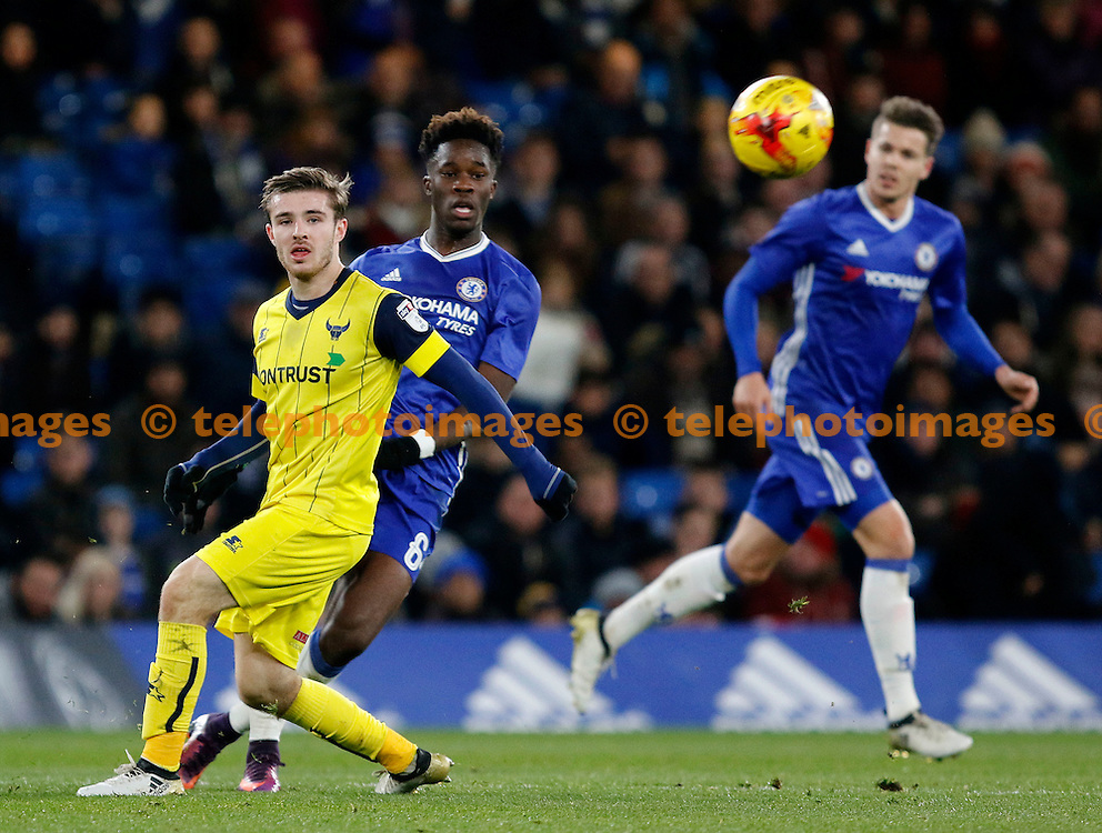 Chelsea's Ike Ugbo is closed down by Oxford's Daniel Crowley during the Checkatrade Trophy match between Chelsea U21's and Oxford United at Stamford Bridge in London. November 8, 2016.<br /> Carlton Myrie / Telephoto Images<br /> +44 7967 642437