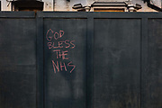 God Bless The NHS chalked up on a fence in Stoke Newington during the coronavirus pandemic on the 10th May 2020 in London, United Kingdom.