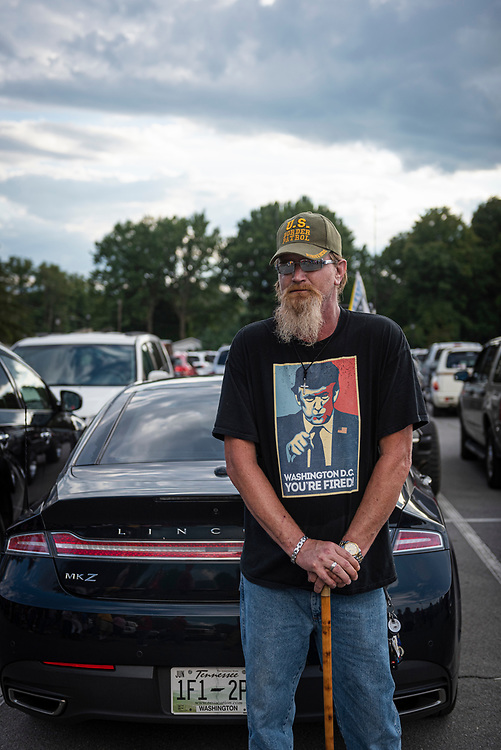 Johnson City, Tennesse - October 1, 2018: Robert Biddy from Crandall, Georgia stands to the side of a long line of people outside Freedom Hall, where President Trump would be holding a rally. Trump was the first sitting president to visit Johnson City since Gerald Ford in 1976.