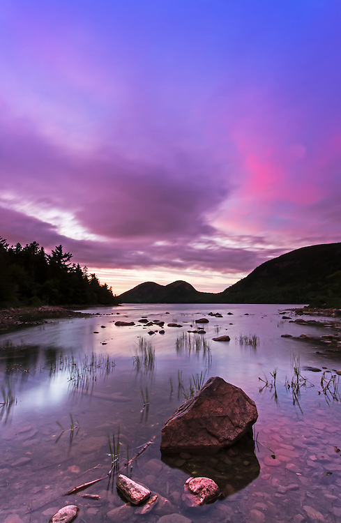 Dramatic cloudscape at Jordan Pond in the early fall as seen at sunset. This beautiful pond is in the heart of Acadia National Park on Mount Desert Island and one of the best photo location for seascape photography. The shore line and rocks in the foreground provide interesting elements for pleasing  compositions while the South and North Bubbles in the background are iconic photo subjects. <br /> <br /> Jordan Pond and the Bubbles seascape photos are available as museum quality photography prints, canvas prints, acrylic prints, wood or metal prints. Prints may be framed and matted to the individual liking and room decor needs:<br /> <br /> http://juergen-roth.pixels.com/featured/dramatic-sunset-at-jordan-pond-juergen-roth.html<br /> <br /> Good light and happy photo making! <br /> <br /> My best, <br /> <br /> Juergen <br /> Image Licensing: http://www.RothGalleries.com <br /> Fine Art Prints: http://fineartamerica.com/profiles/juergen-roth.html <br /> Photo Blog: http://whereintheworldisjuergen.blogspot.com <br /> Twitter: https://twitter.com/naturefineart <br /> Facebook: https://www.facebook.com/naturefineart <br /> Instagram: https://www.instagram.com/rothgalleries