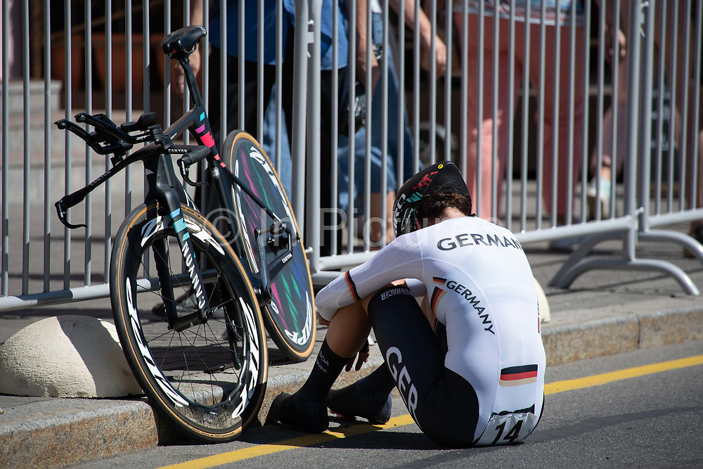 An exhausted Christa Riffel, Germany, following the women's cycling time trail event during the 2019 Minsk European Games on the 25th June 2019 in Minsk City in Belarus.