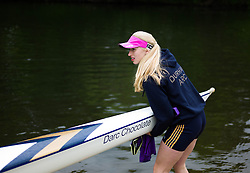 © Licensed to London News Pictures.13/06/15<br /> Durham, England<br /> <br /> A woman lowers her boat into the water during the 182nd Durham Regatta rowing event held on the River Wear. The origins of the regatta date back  to commemorations marking victory at the Battle of Waterloo in 1815. This is the second oldest event of this type in the country and attracts over 2000 competitors from across the country.<br /> <br /> Photo credit : Ian Forsyth/LNP