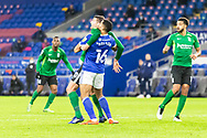 Cardiff City's Curtis Nelson (16) under pressure from Birmingham City's Lukas Jutkiewicz (10) during the EFL Sky Bet Championship match between Cardiff City and Birmingham City at the Cardiff City Stadium, Cardiff, Wales on 16 December 2020.