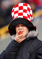 Aberdeen fan eats a pie in the stands before the cinch Premiership match at Pittodrie Stadium, Aberdeen. Picture date: Sunday October 3, 2021.