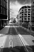 EDITORS NOTE: Image has been converted to black and white. London Wall in The City of London is deserted due to lockdown as a result of the Coronavirus Pandemic on 16th April 2020 in London, United Kingdom. Coronavirus or Covid-19 is a new respiratory illness that has not previously been seen in humans. Much of Europe has been placed into lockdown, with stringent rules in place as part of a long term strategy, and in particular social distancing, and a stay at home policy.