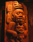 """'IIxt"""" Ga'as' or Shaman Housepost by doorway of Chief Shakes Tribal House.  Steve Brown, Wayne Price and Will Bulkhardt carved these replication posts in 1985.  Wrangell, Alaska."""