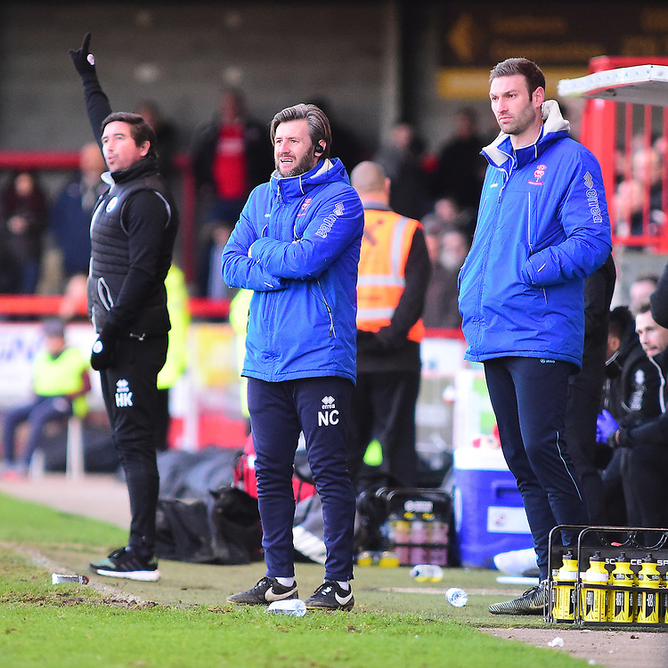 Lincoln City's assistant manager Nicky Cowley shouts instructions to his team from the technical area<br /> <br /> Photographer Andrew Vaughan/CameraSport<br /> <br /> The EFL Sky Bet League Two - Crawley Town v Lincoln City - Saturday 17th February 2018 - Broadfield Stadium - Crawley<br /> <br /> World Copyright © 2018 CameraSport. All rights reserved. 43 Linden Ave. Countesthorpe. Leicester. England. LE8 5PG - Tel: +44 (0) 116 277 4147 - admin@camerasport.com - www.camerasport.com