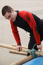 Visually impaired man doing raft-building activity at the National Water Sports Centre.