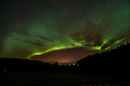 07.10.2015 Daviot, Inverness. The Aurora Borealis (Northern Lights) light up the sky above Inverness in the Highlands of Scotland. The Aurora Borealis is an incredible light show caused by collisions between electrically charged particles released from the sun that enter the earth's atmosphere and collide with gases such as oxygen and nitrogen. The lights are seen around the magnetic poles of the northern and southern hemispheres.
