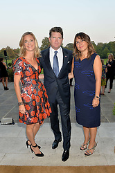 Left to right, BROOKE BARZUN, MATTHEW BARZUM and ALEXANDRA SHULMAN at a party hosed by the US Ambassador to the UK Matthew Barzun, his wife Brooke Barzun and editor of UK Vogue Alexandra Shulman in association with J Crew to celebrate London Fashion Week held at Winfield House, Regent's Park, London on 16th September 2014.