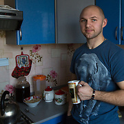 """CAPTION: Aleksander Panteleeyev, father of cleft lip patient Valentina Panteleeyeva, at home in Volzhskiy, near Volgograd. """"I was very, very happy when I found out I was going to be a father"""", he says. """"I had the sense that I was realising my life purpose. Together, we wanted to do the best for this child"""". LOCATION: Volzhskiy, Volgograd Oblast, Russia. INDIVIDUAL(S) PHOTOGRAPHED: Aleksander Panteleeyev."""
