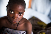 A girl suffering from cholera sits on her bed at the Virunga cholera treament center in Goma, Eastern Democratic of Congo on Monday December 15, 2008.