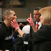 """Juan Castillo gets an after fight checkup after beathing Luis Rodriguez during a """"Boxeo Telemundo"""" boxing match at the Kissimmee Civic Center on Friday, July 18, 2014 in Kissimmee, Florida. (AP Photo/Alex Menendez)"""