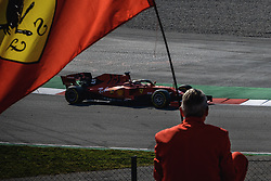 March 1, 2019 - Barcelona, Catalonia, Spain - A lonely Ferrari fan looks on as SEBASTIAN VETTEL (GER) from team Ferrari drives in his SF90 during day eight of the Formula One winter testing at Circuit de Catalunya (Credit Image: © Matthias OesterleZUMA Wire)