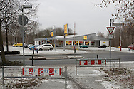 A supermarket standing on the site of the former Berlin Wall, in Pankow, a district of northern Berlin. The route of the Wall, which stood from 1962-1989, has been developed into the 'Mauerweg,' a thoroughfare which traces most of the route of the Wall which encircled the city and divided it into East and West Berlin during the Cold War. In the years following the 1989 civil uprising in the German Democratic.Republic, most of the Wall was removed as part of the reunification strategy which united the pro-Soviet DDR and the Federal Republic of (West) Germany.