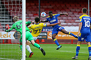 GOAL 1-0 AFC Wimbledon attacker Zach Robinson (14) heads past Brighton and Hove Albion goalkeeper Carl Rushworth (62) during the EFL Trophy Southern Group G match between AFC Wimbledon and Brighton and Hove Albion U21 at The People's Pension Stadium, Crawley, England on 22 September 2020.