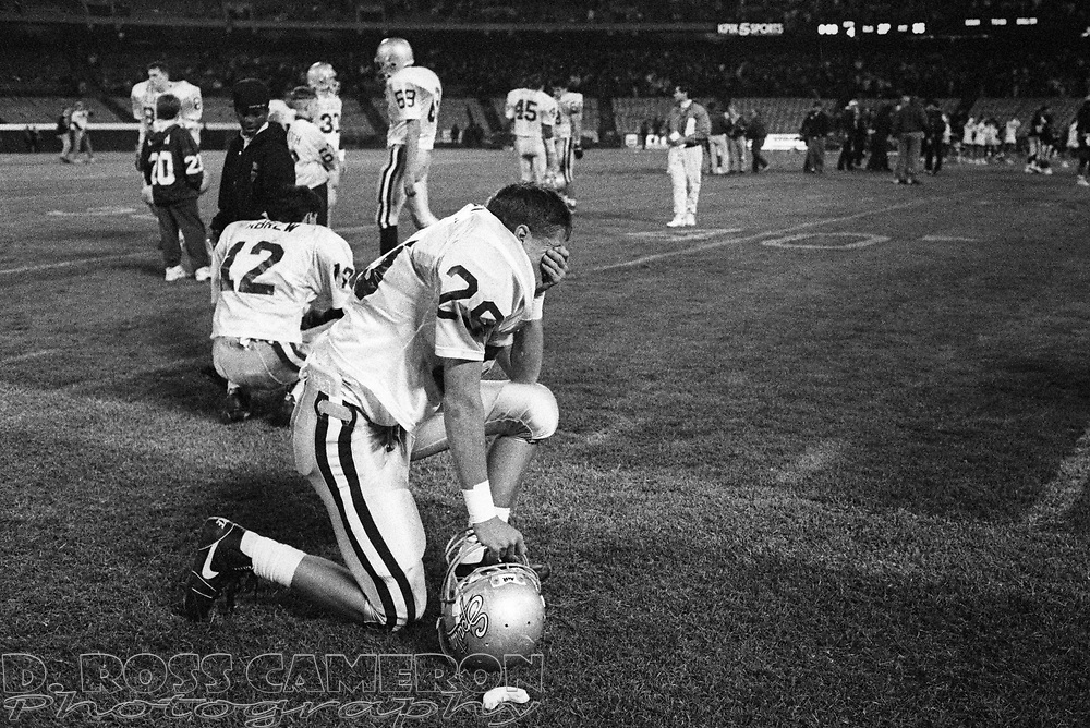 De La Salle High School running back Jay Hoffman (29) wipes away tears after his team lost to Pittsburg in the NCS Division III football championship game, Saturday, Dec. 7, 1991 at Oakland-Alameda County Coliseum in Oakland, Calif. The Spartans, who were unbeaten and a heavy favorite, were upset by the Pirates, 35-27. (D. Ross Cameron/Tri-Valley Herald)
