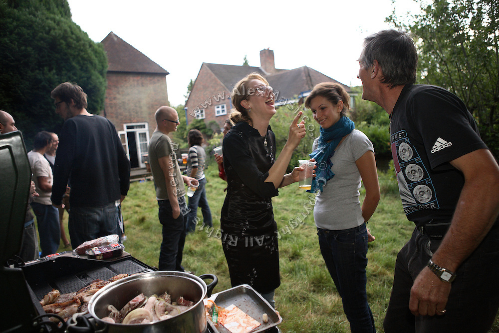 Romana, 29, from Czech Republic, (centre) is having fun cooking a barbecue for her guests with Calin's father, Samuile, 55, from Romania (right), in the back garden of the Wildwood Road mansion on Saturday, July 14, 2007, in Hampstead, London, England. Situated opposite Hampstead Heath, North London's green jewel the average price for properties on this road reaches UK£ 2,500,00. Million Dollar Squatters is a documentary project in the lives of a peculiar group of squatters residing in three multi-million mansions in one of the classiest residential neighbourhoods of London, Hampstead Garden. The squatters' enthusiasm, their constant efforts to look after what has become their home, their ingenuity and adventurous spirit have all inspired me throughout the days and nights spent at their side. Between the fantasy world of exclusive Britain and the reality of squatting in London, I have been a witness to their unique story. While more than 100.000 properties in London still lay empty to this day, squatting provides a valid, and lawful alternative to paying Europe's most expensive rent prices, as well as offering the challenge of an adventurous lifestyle in the capital.