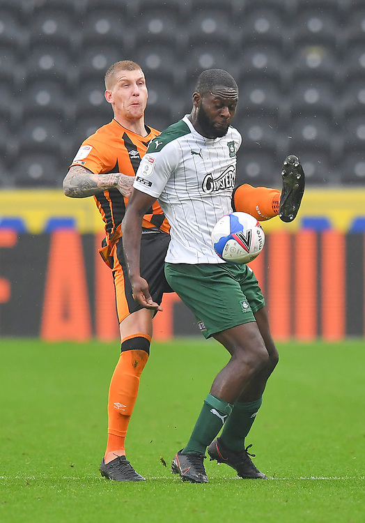 Hull City's Jordy de Wijs battles with Plymouth Argyle's Frank Nouble<br /> <br /> Photographer Dave Howarth/CameraSport<br /> <br /> The EFL Sky Bet League One - Hull City v Plymouth Argyle - Saturday 3rd October 2020 - KCOM Stadium - Kingston upon Hull<br /> <br /> World Copyright © 2020 CameraSport. All rights reserved. 43 Linden Ave. Countesthorpe. Leicester. England. LE8 5PG - Tel: +44 (0) 116 277 4147 - admin@camerasport.com - www.camerasport.com