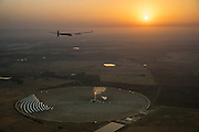Seville, Spain, July 11th 2016: Solar Impulse is flying over the Torresol Energy's Gemasolar Thermosolar Plant, which is partially owned by Masdar, Solar Impulse's host partner in Abu Dhabi, after taking off from Seville to Cairo, Egypt with André Borschberg at the controls. Departed from Abu Dhabi on march 9th 2015, the Round-the-World Solar Flight will take 500 flight hours and cover 35'000 km. Swiss founders and pilots, Bertrand Piccard and André Borschberg hope to demonstrate how pioneering spirit, innovation and clean technologies can change the world. The duo will take turns flying Solar Impulse 2, changing at each stop and will fly over the Arabian Sea, to India, to Myanmar, to China, across the Pacific Ocean, to the United States, over the Atlantic Ocean to Southern Europe or Northern Africa before finishing the journey by returning to the initial departure point. Landings will be made every few days to switch pilots and organize public events for governments, schools and universities.