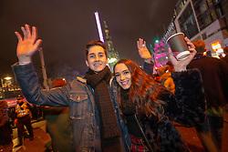 Callum Keenan and Colleen Thomson. Revelers in Princes Street. Hogmanay in Edinburgh.