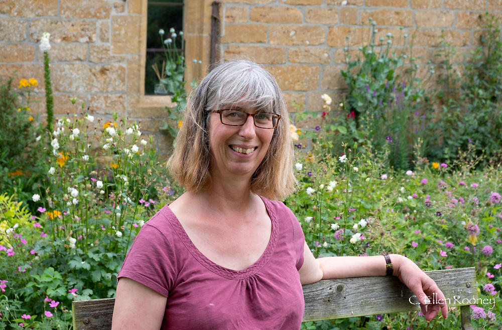 Mary Pring in her garden at Lower Severalls Farmhouse, Crewkerene, Somerset, UK