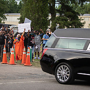 RAEFORD, NC - June 6: The body of George Floyd departs to a cheering crowd at his memorial service in Raeford, NC on June 6, 2020. The 3 day tour will culminate with Floyd's funeral in Houston, Texas. (Photo by Logan Cyrus for AFP)