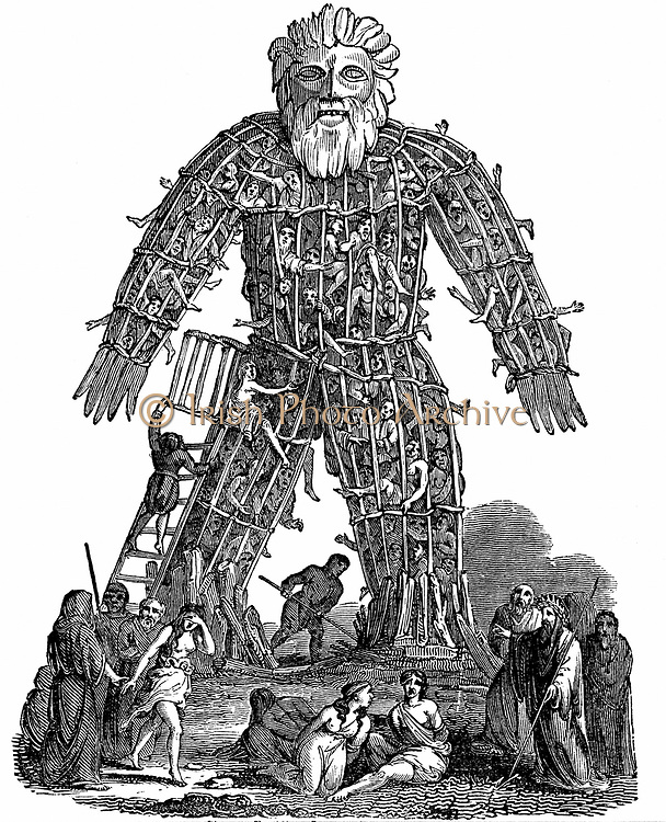 Druids making human sacrifice to their gods, based on report by Julius Caesar. Druids, the priests, teachers and judges of Celts suppressed by Romans c50 AD. Woodcut 1832. Wicker Man.