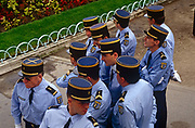A group of Gendarme officers gather during the annual Bastille Day celebrations on the streets of the French capital. With arms folded they clearly have more of a wait before being called upon to officiate or even parade themselves. As the military might of the nation passes-by followed by the French President along Paris' Champs-Elysees in the French capital, citizens and security personnel gather along the boulevard.
