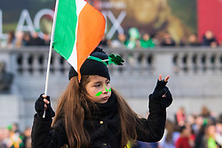 London, March 13th 2016. The annual St Patrick's Day Festival takes place in Trafalgar Square with performances on stage and plenty of Irish food and drink for the thousands of revellers.  PICTURED: A girl perched on someone's shoulders enjoys a clear view of the stage. ©Paul Davey<br /> FOR LICENCING CONTACT: Paul Davey +44 (0) 7966 016 296 paul@pauldaveycreative.co.uk